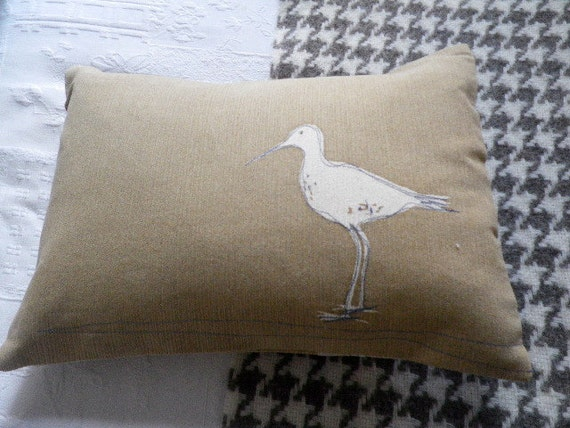 hand screen printed and stitched gold wading bird cushion