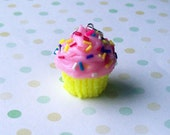 pink cupcake charm with rainbow sprinkles