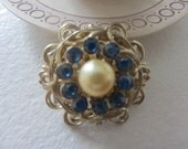 Vintage 1919 Coro Faux Pearl brooch with blue stones