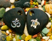 Wisdom guitar pick, Custom made Ebony guitar pick or pendant inlayed with a mother of pearl Ohm sign and a Wise Turtle