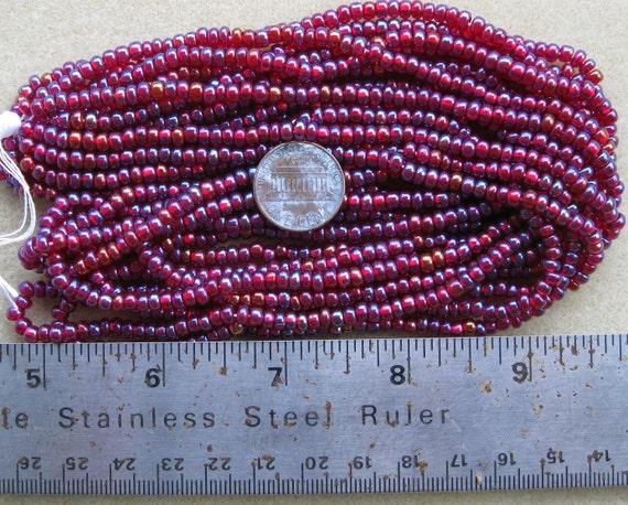 Czech Jablonex Preciosa Ornela seed beads, ruby rainbow, 6/0, 1/2 hank