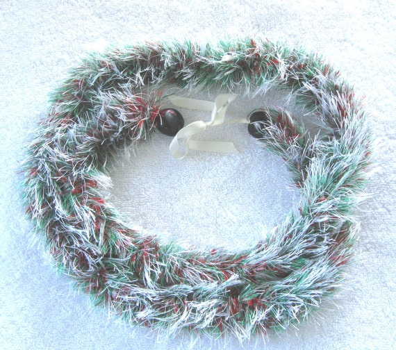 White, red and green eyelash lei, finished with black kukui nuts