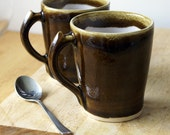 One stoneware tea mug - glazed in toffee brown and white