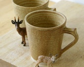 Two stoneware tea mugs - glazed in natural brown
