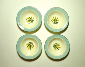 FOUR aqua rimmed wheat bowls