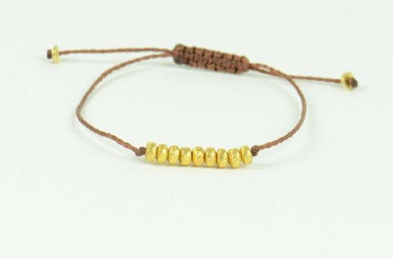 Gold friendship cord bracelet