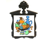 Vintage Iron and Ceramic Trivet with Colorful Food Still Life