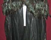 Leather cloak accented with feathers