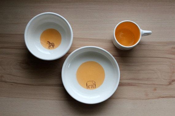 child's pottery set.  african animals, orange.