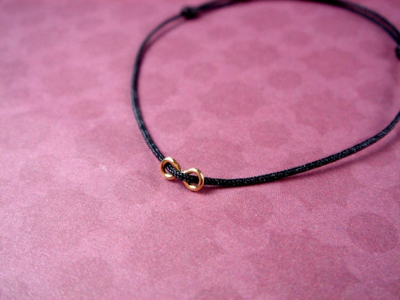 Reserved for Megan - High Polished Gold Infinity Charm on Black String Bracelet by - BYAE on Etsy.