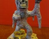 Big Head Mummy Sculpture