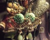 pierced jade earrings
