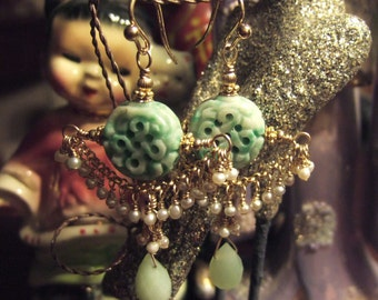 pierced jade earrings