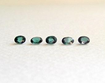 0.70tcw green-blue tourmaline oval brilliants