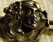 Antique - a tiny little Art Nouveau girl - brooch / pin - Sterling