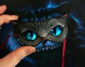 Last one. Cheshire cat mask