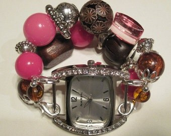 Chunky brown, pink and silver acrylic beaded interchangeable watch band. Silver watch face with rhinestones included