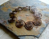 Rustic Bracelet. Copper. Metalwork. Spirals. Wire Work.  Metal. Linked Bracelet. Patina. Circle Shape - fitzUniqueli