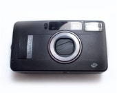 Fujifilm Black Natura F1point9 free natura 1600 ISO film. fast lens including Natura Case