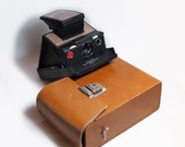 Polaroid SX-70 Alpha, with Tripod mount, strap hole and 100% working.