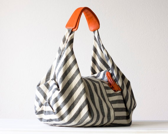 Kallia in Striped canvas and Orange leather details