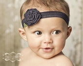 BEST SELLER... Black and White Polka Dot MADISON blossom on Black Stretchy Infant Headband. Perfect Gift for Baby Shower, Birthday, for a Wedding, as a Prop for Newborn Photo Shoots.