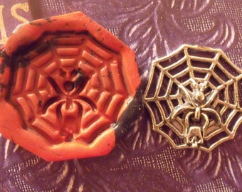 Spider web with skull polymer clay mold