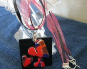 Polymer Clay Hearts On a black Background Strung on Ribbon and hemp necklace in red, orange and black