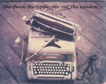 She threw the typewriter out the window../photo postcard
