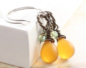 Antique finish brass earrings with clustered honey yellow matte finish Czech glass teardrops and light green Swaorovski crystals