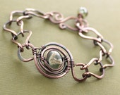Lampwork copper bracelet with a handmade chain in adjustable length.
