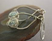 Pear shape silver earrings with herringbone wrapped luster aquamarine color lampwork glass Aquamarine earrings
