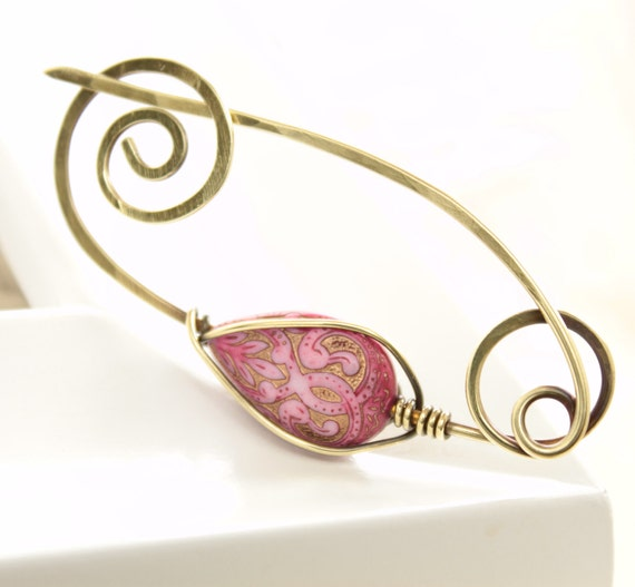 Brass shawl pin or scarf pin with caged golden fuchsia pink lucite drop bead