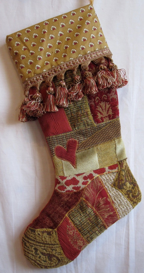 Victorian crazy quilt christmas stocking in red tan gold patchwork