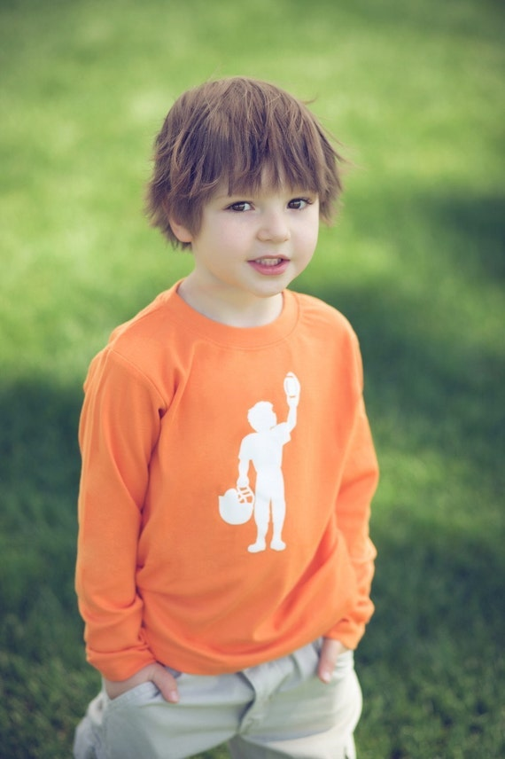 Football Player Long Sleeved Nostalgic Graphic Tee in Orange with White