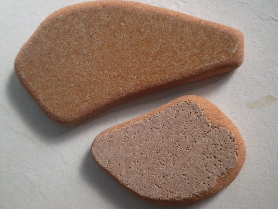 THIS AND THAT - 2 genuine Pottery Beach Stones