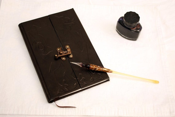 Hand bound leather notebook with metal lock with medieval dragon engraved
