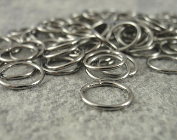 100 Soldered Closed GunMetal Jump Rings 18 gauge 10mm OD