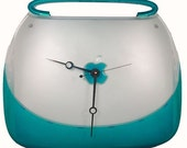 TEcoArt's iClock is a former Apple iBook Blueberry Clamshell Laptop recycled as one, Unique Clock.