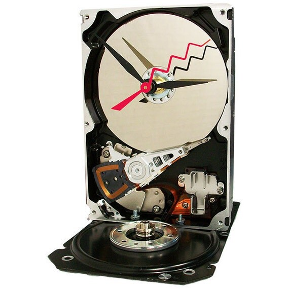 Hard Drive Clock Accented with Disk Clamp, Spindle Shaft and Zigzag Hand. (H)