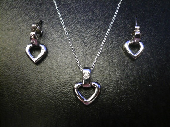 SALE... Exceptional Sterling Silver .925 heart pendant and white sapphire set.