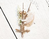 B. Poetic Boutonniere in Metallic Earth