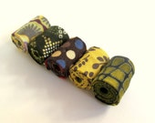 Hand rolled artisan fiber beads in Golden dream printed cotton