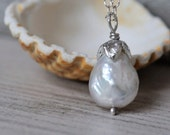 Solitary white pearl necklace. Sterling silver necklace with freshwater pearl.