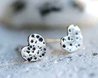 Small heart stud earrings, textured silver and patinated