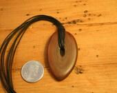 Salvaged walnut wood pendant