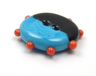 Handmade lampwork glass button  -  Turquoise and Black  -  orange dots
