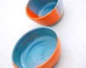 two bowls in orange and turquoise