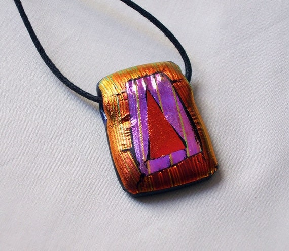 Fiery orange pink and red fused dichroic glass pendant