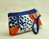 Reserved for Lindsey: Zippered clutch in vintage fabric with orange flowers and blue dots
